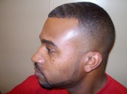 a black colored male with a new fade haircut