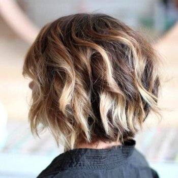 choppy chin-length bob with blonde shows