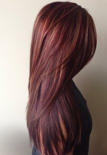 Dark red wealthy hair color with caramel highlights