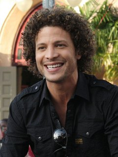 Justin Guarini with his frizzy hair as a male with curls kind IIwe