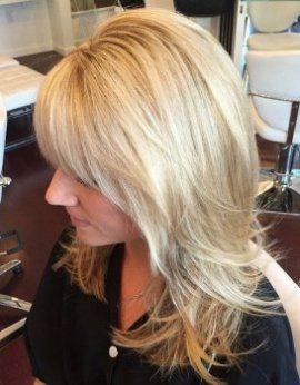 layered blond haircut for moderate hair