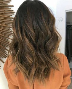medium brownish locks with caramel balayage